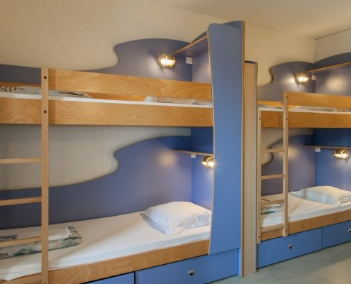 4 beds Bedroom 495x400 - Accommodation in a Youth Hostel